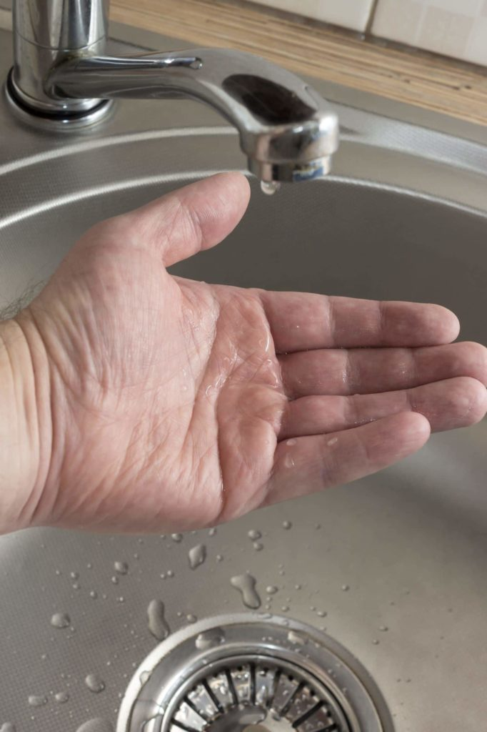 hand and water, leaking faucet