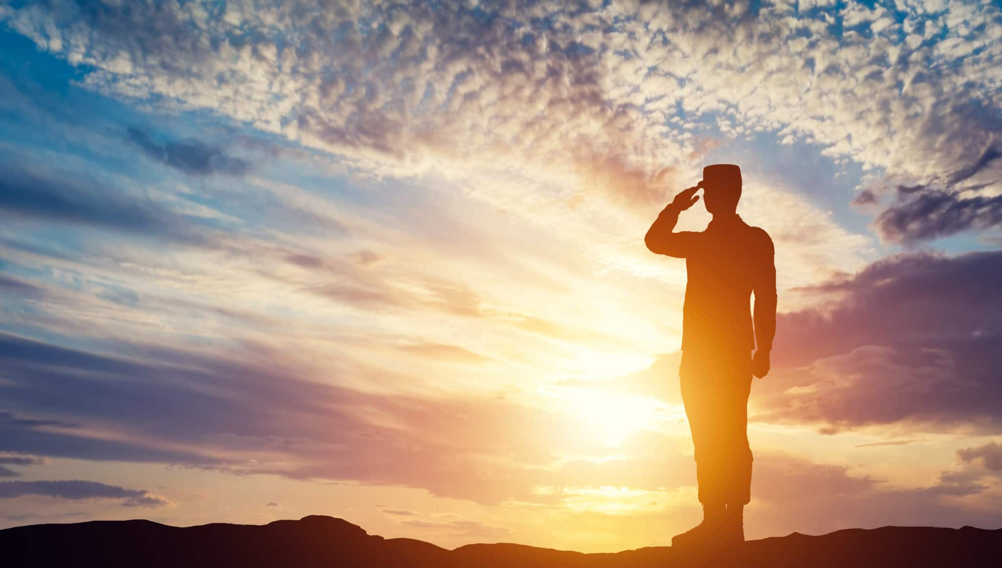 honor our warriors soldier saluting in front of sunset